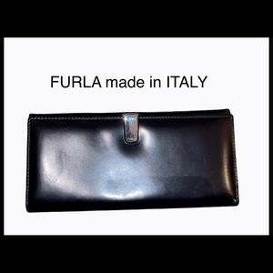 FURLA leather wallet with silver clasp.